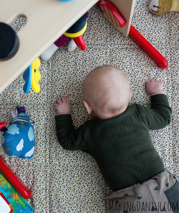 tummy time activity center and toys