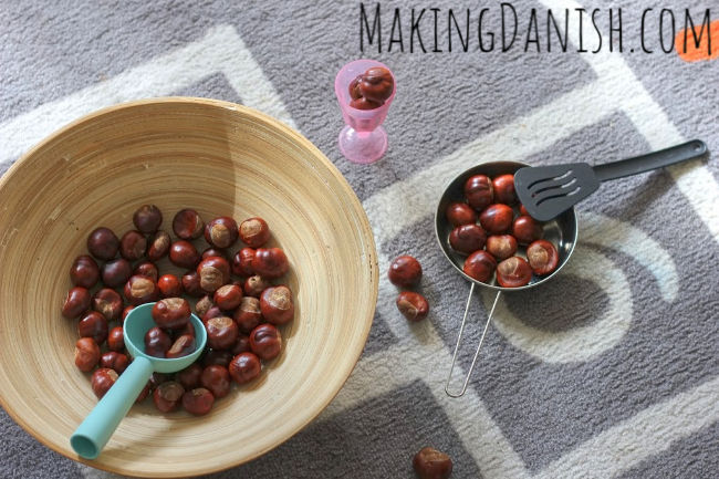 sensory bin with conkers kitchen utensils pretend play
