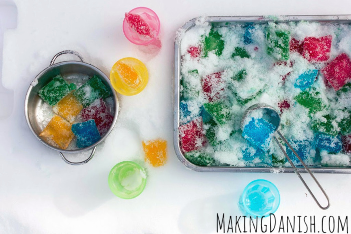scooping coloured ice cubes in the snow