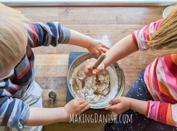 kids mixing and baking cinnamon rolls